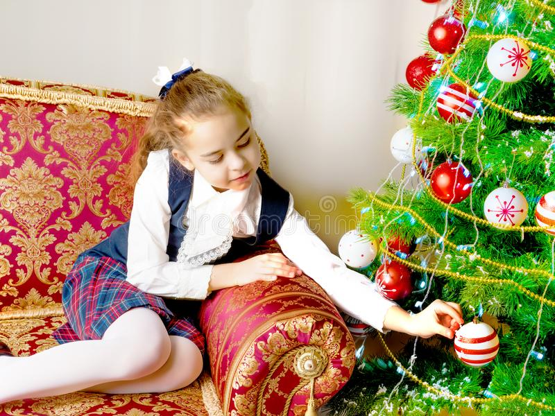 The girl at the Christmas tree. stock photography