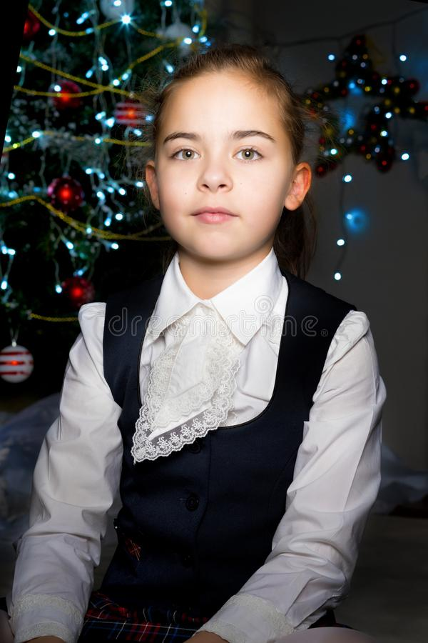 The girl at the Christmas tree. stock images