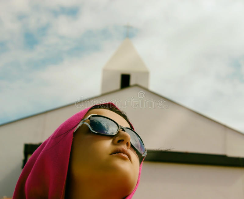 Girl With Church In Background royalty free stock photos