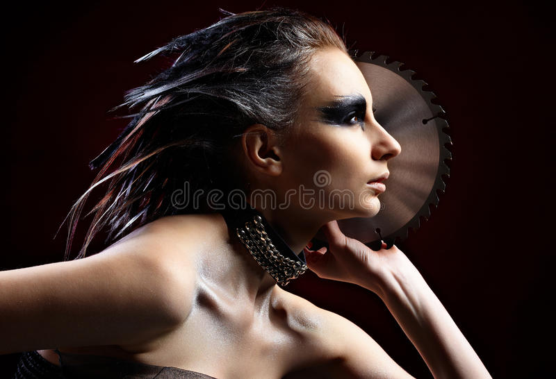 Girl with circular saw. Young beautyful Woman with circular saw in hand royalty free stock image
