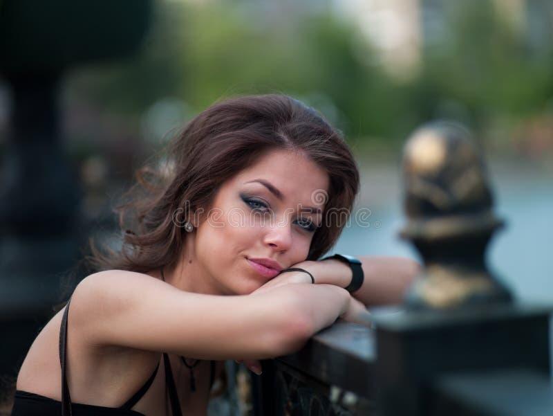Girl in the city near the bridge stock photography