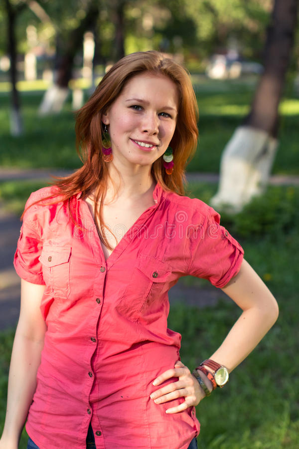 A girl in a city park royalty free stock photography