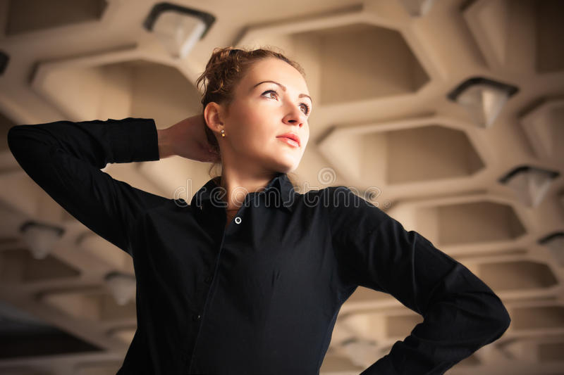 Girl city portrait. Portrait of red-haired girl on the background of the city building royalty free stock photo