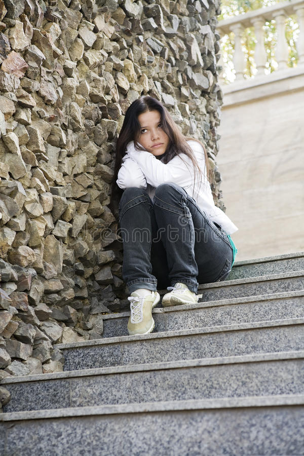 Girl at the city, problems stock photography