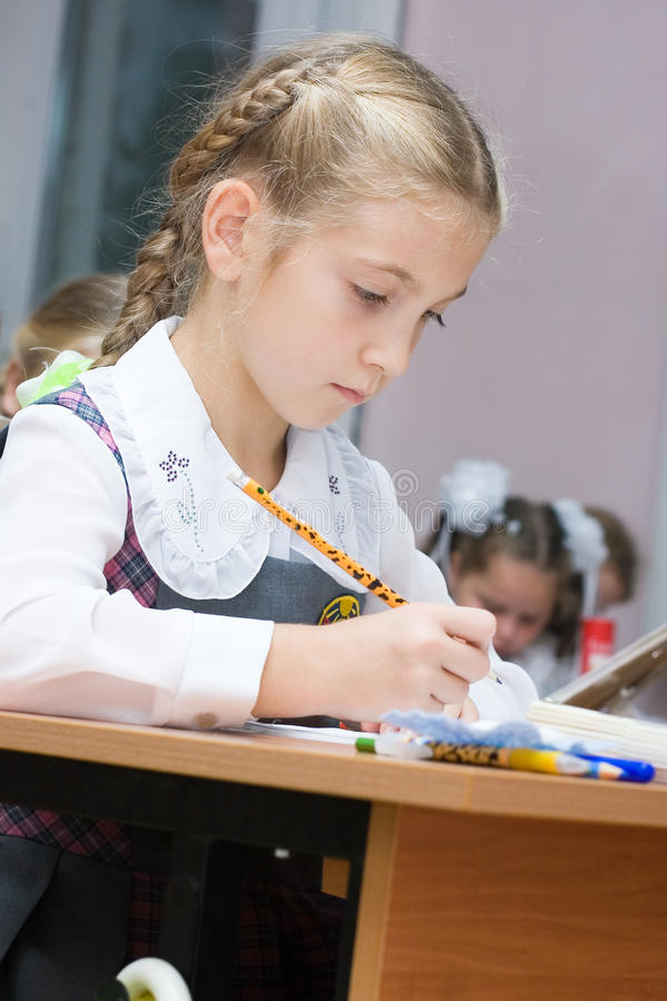 Girl in the classroom royalty free stock photography