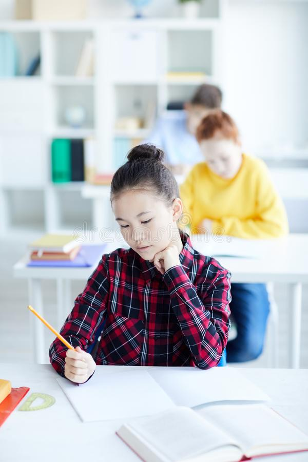 Girl in classroom royalty free stock photo