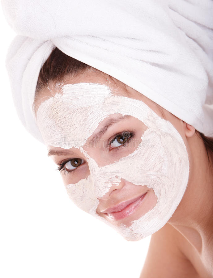 Girl with clay facial mask. Young womanl with clay facial mask stock images
