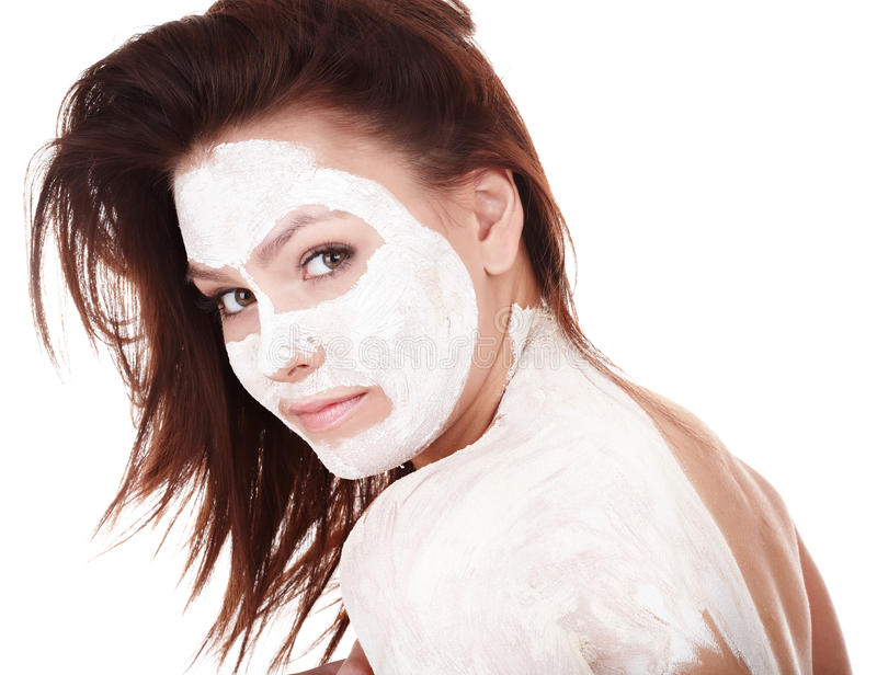 Girl with clay facial mask. Young womanl with clay facial mask stock photo