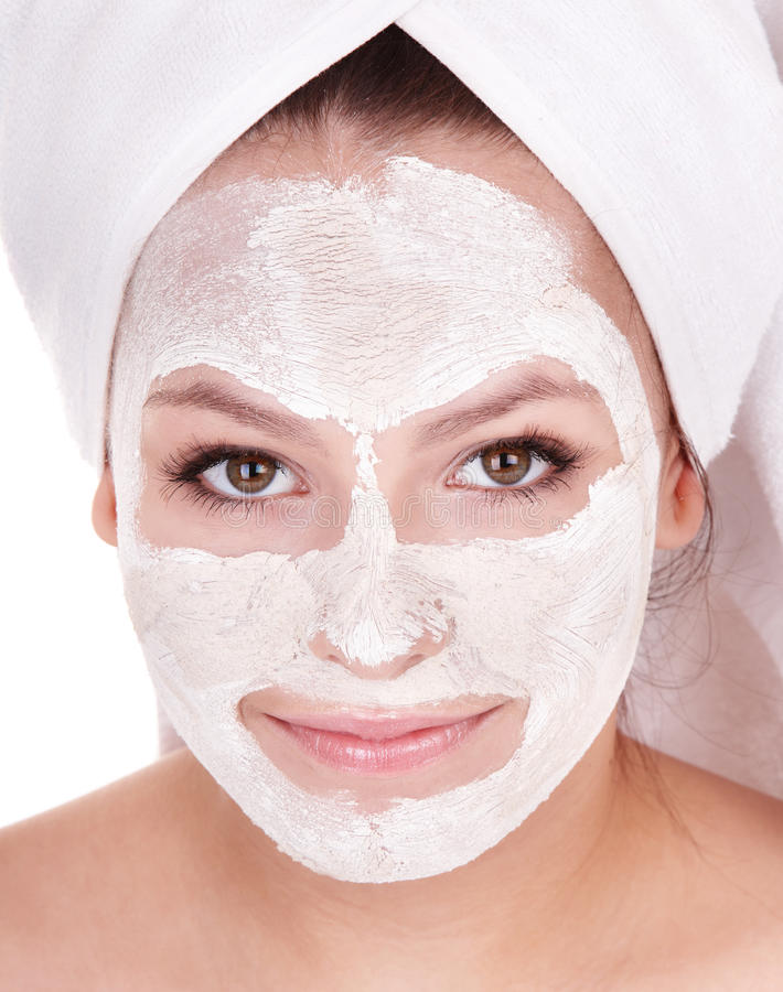 Girl with clay facial mask. Young woman with clay facial mask stock photography