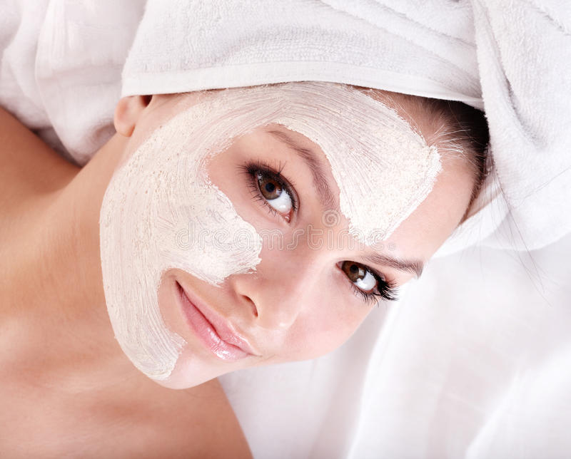 Girl with clay facial mask. Young woman with clay facial mask stock photo