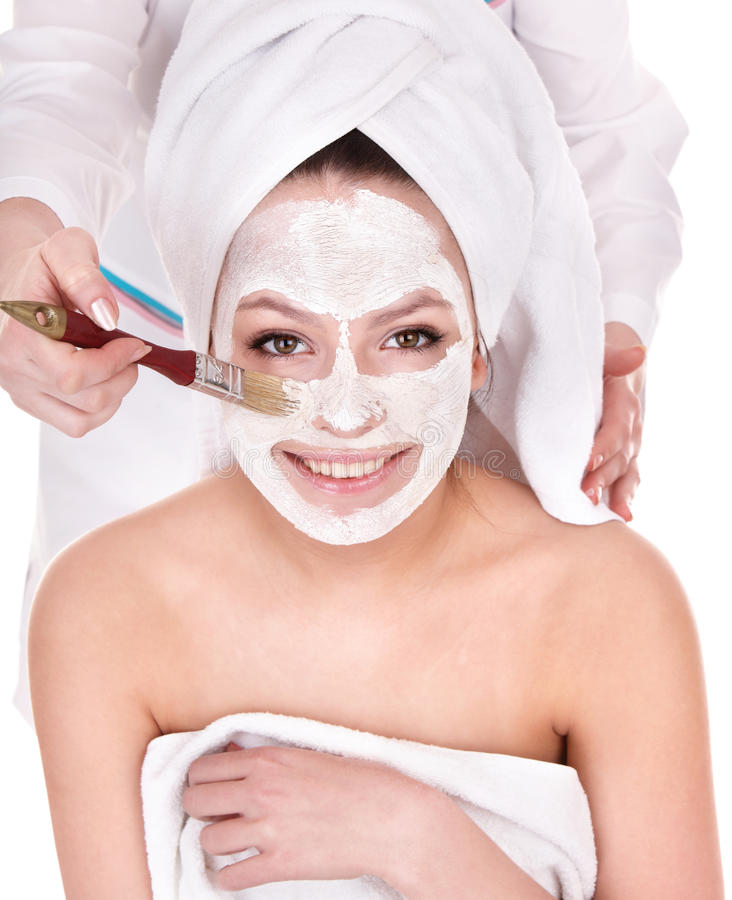 Girl with clay facial mask. Young woman cleaning face by clay facial mask royalty free stock photo
