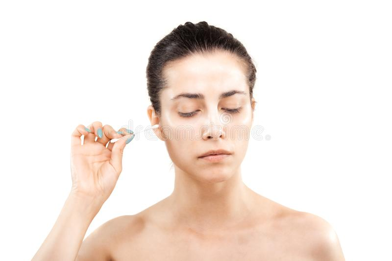 girl with cotton ear stick stock image