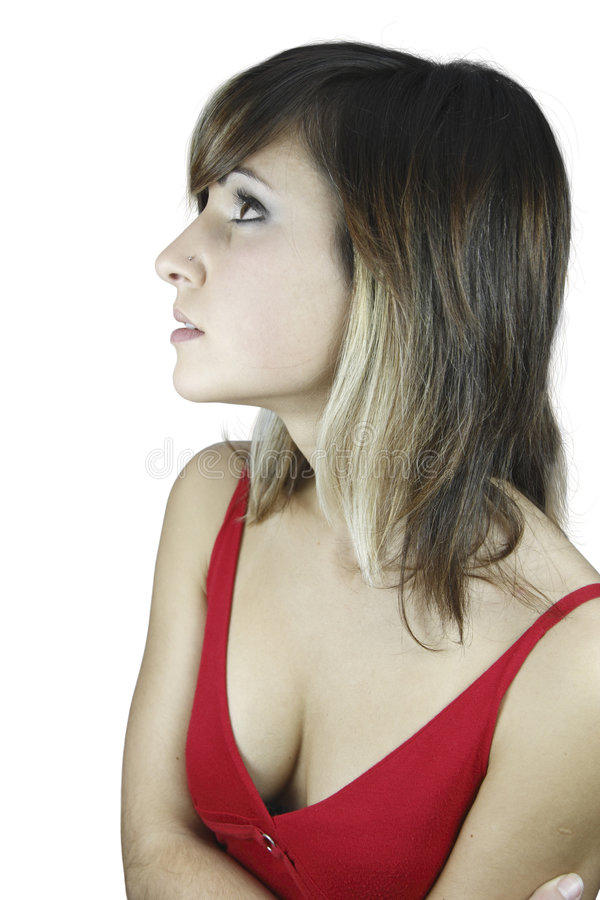 Girl and cleavage. A nice girl in red with a a nose piercing showing her cleavage stock images