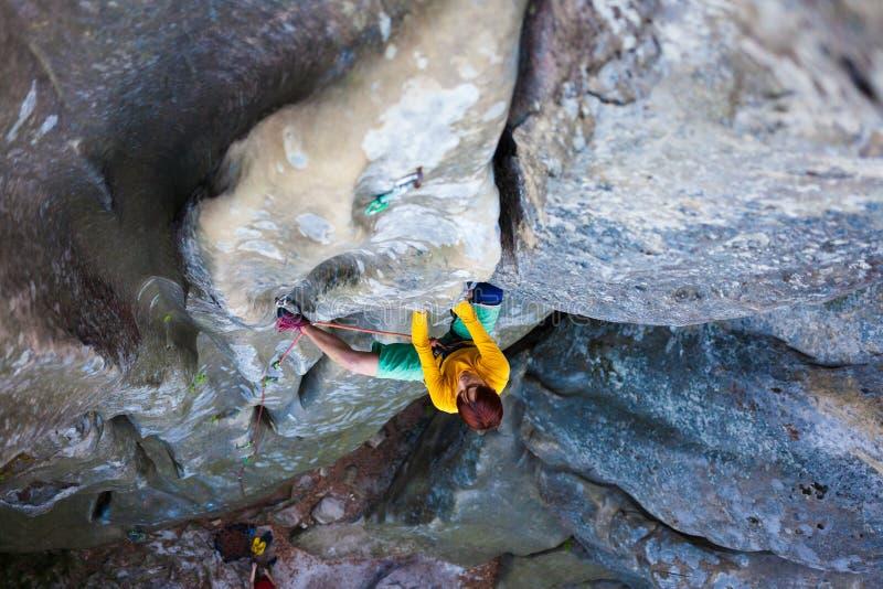 Girl climber climbs the rock. stock photography