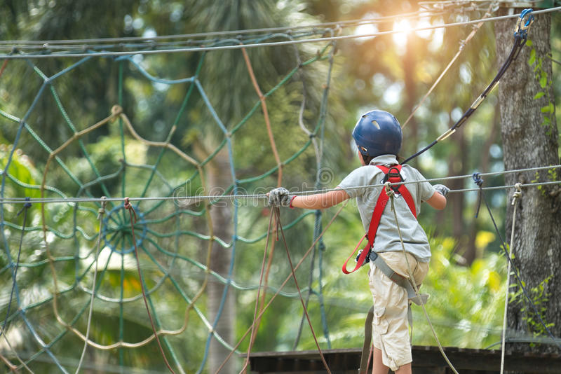 girl climbing in adventure rope park royalty free stock photos