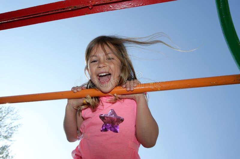Girl on climbing frame royalty free stock photos