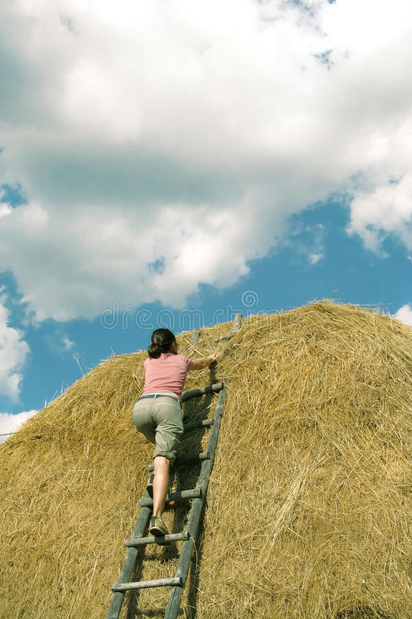 Girl Climbing a Hay royalty free stock images