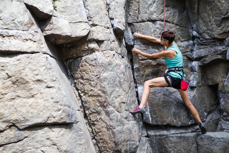 Rock climber is training on natural terrain stock images