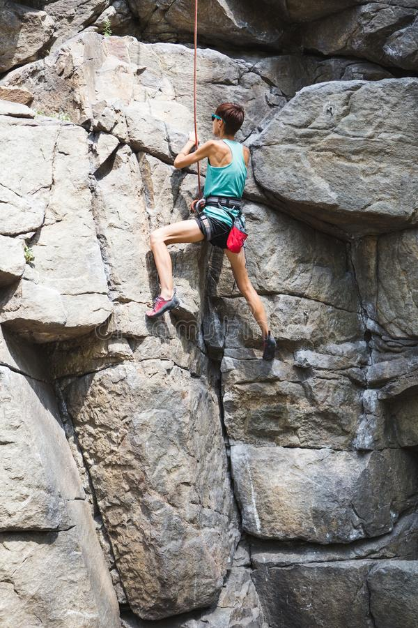 Rock climber is training on natural terrain royalty free stock photo