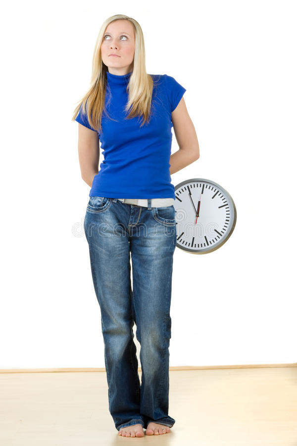 Girl with clock stock photo