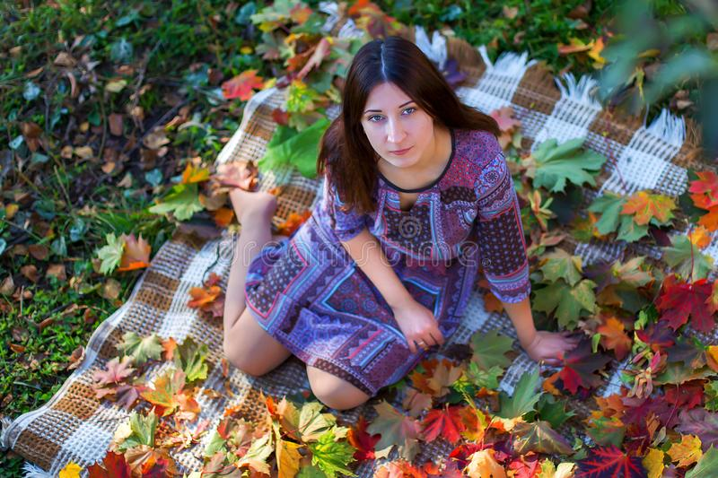 Girl close up in autumn foliage royalty free stock image