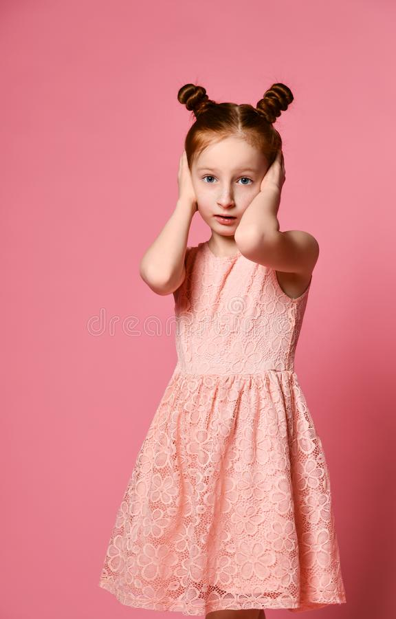 Girl closes ears hands royalty free stock photos