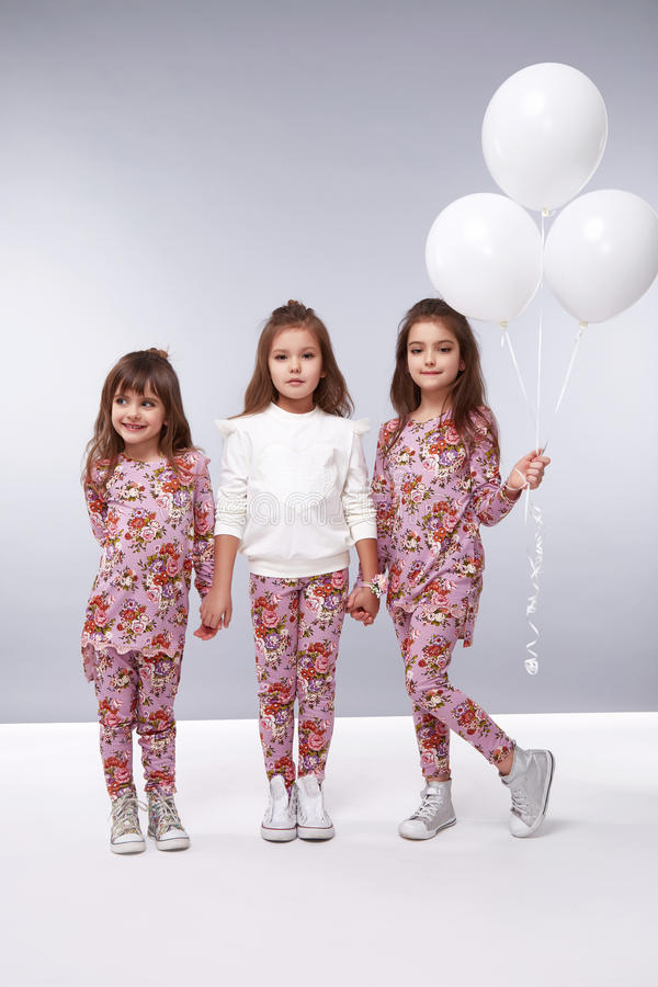 Girl clothes collection little small balloons birthday fashion. Little girls girlfriend in a beautiful stylish fashion clothes new collection of dress suit, are stock images