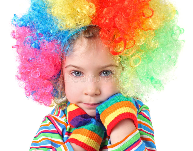 Girl in clown wig and multicolored gloves stock photos