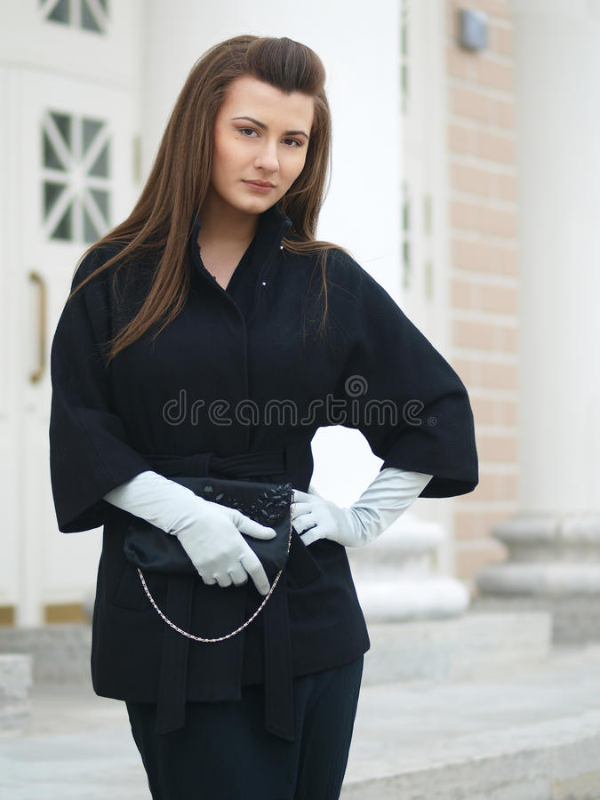 Girl With Clutch Stock Images
