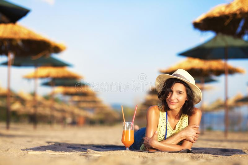 Girl with cocktail on a beach stock photography