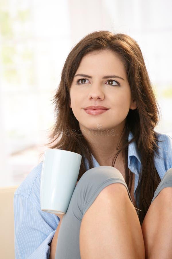 Girl with coffee mug stock photography