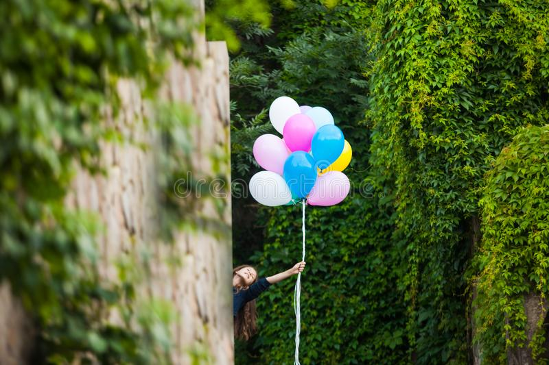 Girl with colorful balloons in the city royalty free stock images