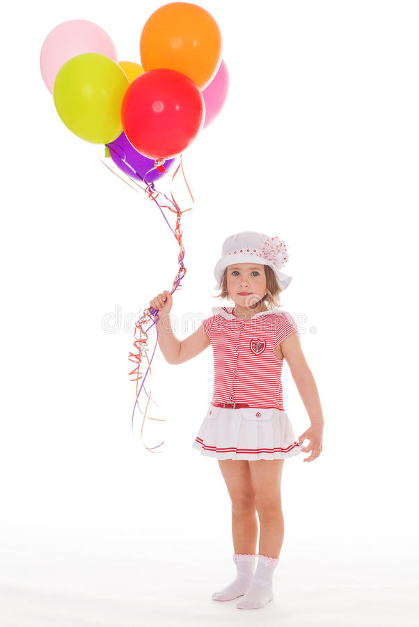 Girl with colorful balloons. stock image