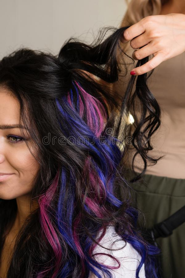 Creating hairstyle. Girl with colorful dyed hair. Model with perfect healthy dyed hair. Master of image creation. Delicate and fun customer service stock photos