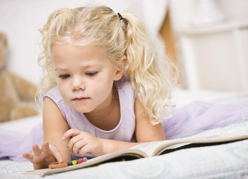Download Girl Coloring in Books stock image. Image of down, lying - 10196503