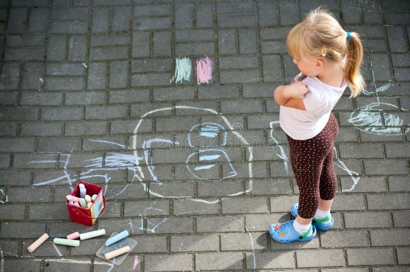 Girl in colourful backyard