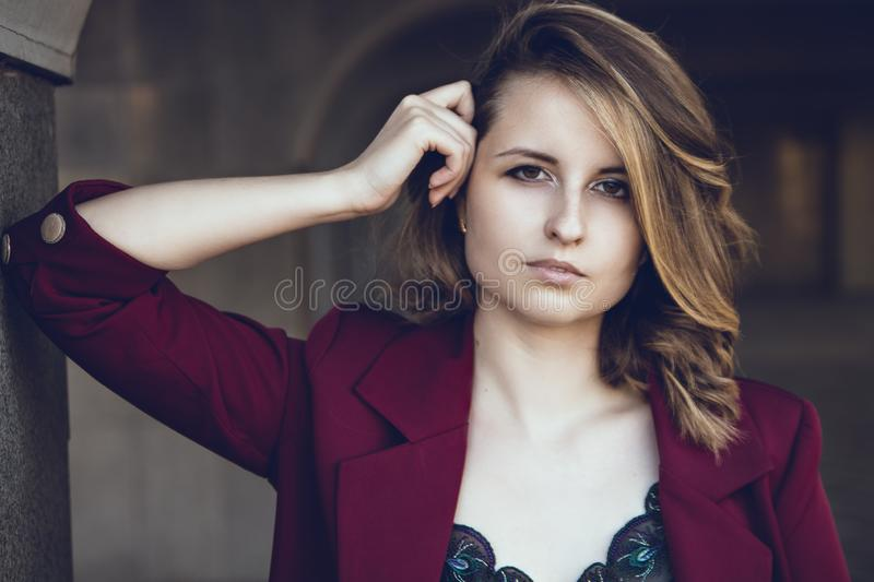 The girl in the columns royalty free stock photo