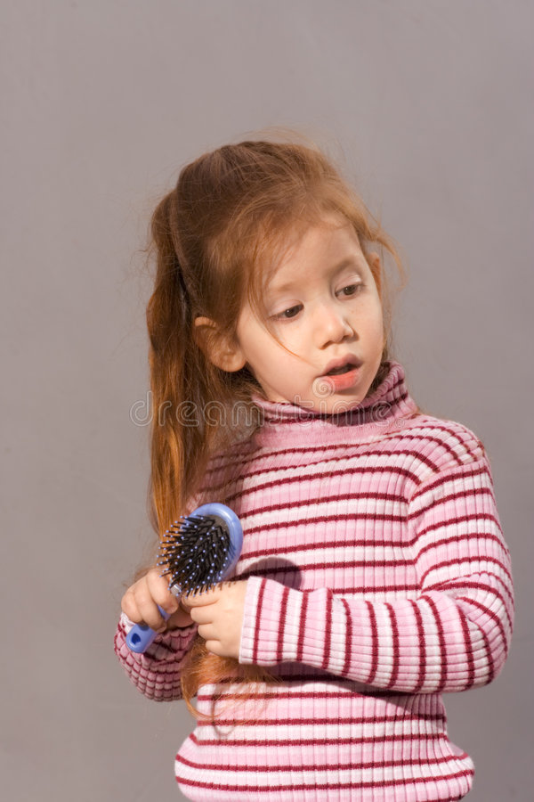 Girl with comb royalty free stock photos