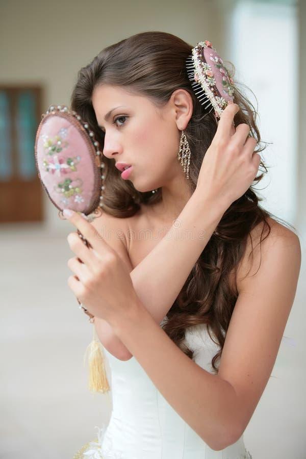 Girl combs hairs royalty free stock photos