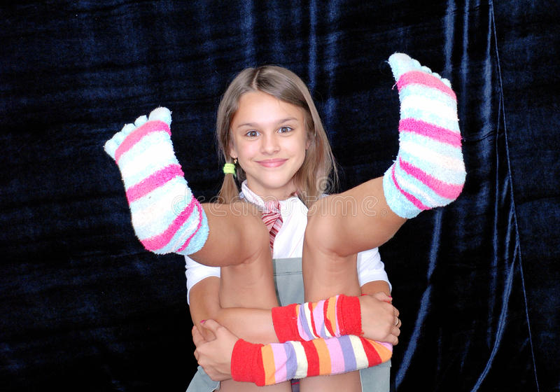 Girl in comfortable socks royalty free stock image