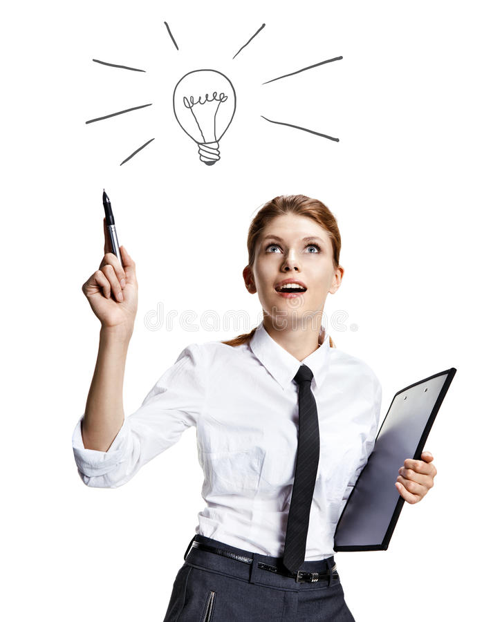 Girl coming up with a light bulb idea sign. Attractive woman wearing a white shirt with a tie and a folder in her hand like the idea - isolated on white stock photo
