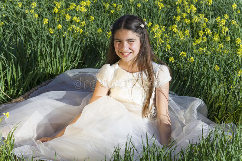 Girl with communion dress royalty free stock images
