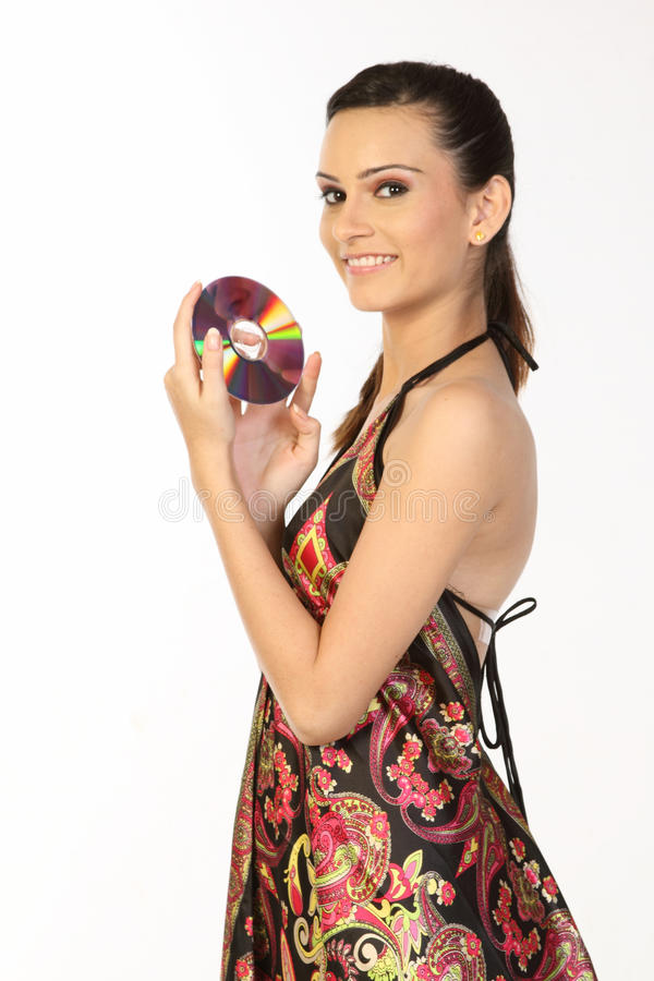Girl with a compact disk in hands. Portrait of the girl with a compact disk in hands royalty free stock images