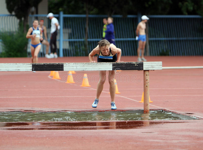Girl compete in the 3.000 Meter Steeplechase