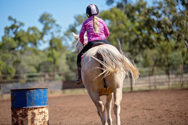 Girl Competing In Barrel Racing At Outback Country Rodeo royalty free stock photo