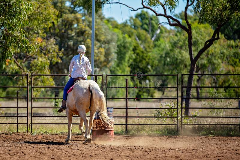Girl Competing In Barrel Racing At Outback Country Rodeo stock photo