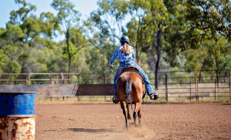 Girl Competing In Barrel Racing At Outback Country Rodeo stock photography
