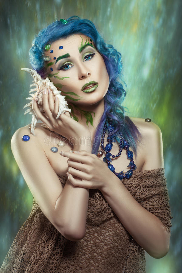 Girl with a conch. stock image
