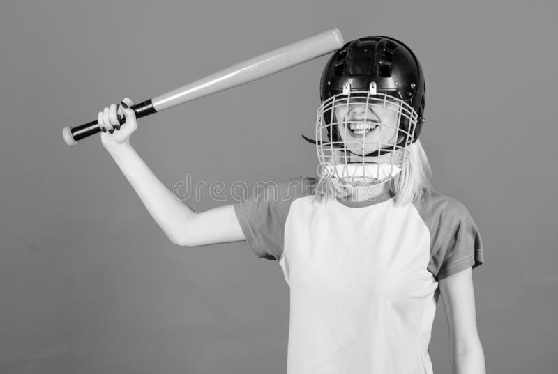 Girl confident pretty blonde wear baseball helmet and hold bat on blue background. Baseball female player concept. Ready royalty free stock photography