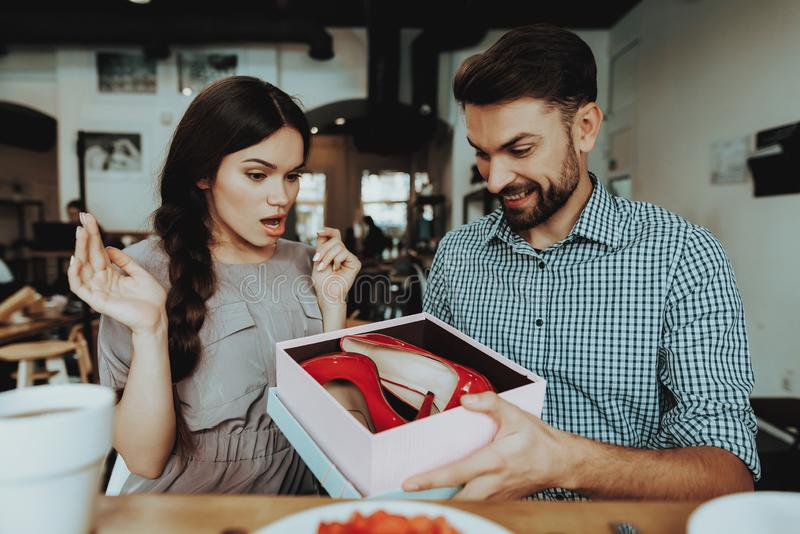 Shoes and Surprise for Young Girl. Girl Confuse. Girl Confuse and Happy. Smile Handsome Man. Spring People Celebrate 8 March. Holiday and Good . Relationship stock image